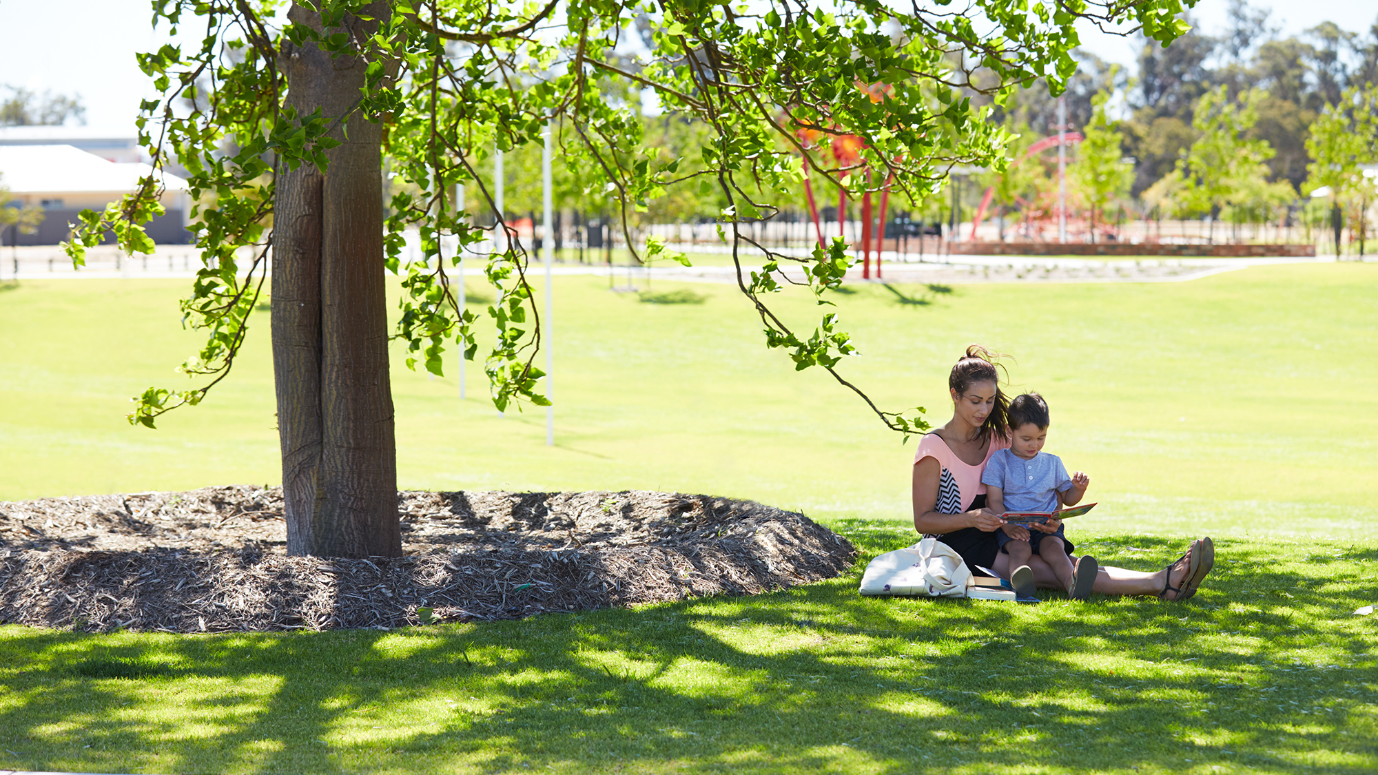 Mum and son in park